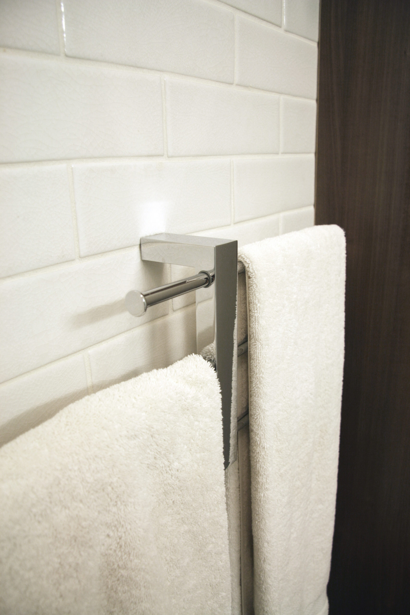 Bathroom towel rail to maximise space in New York City apartment