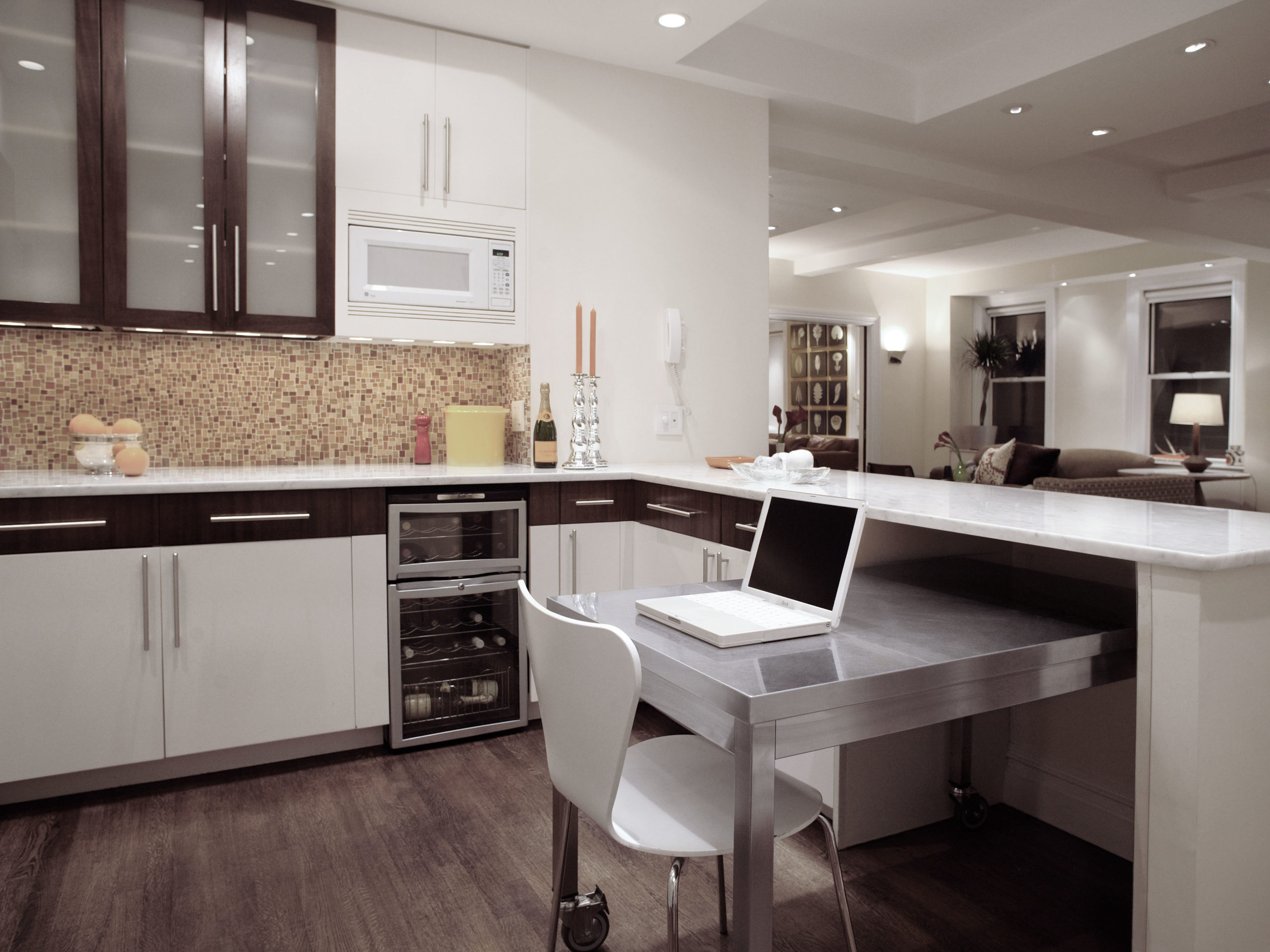 Kitchen design after apartment combination by EXD Architecture